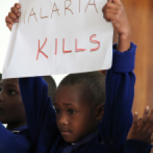 Child holding malaria kills poster